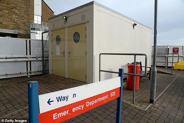 The coronavirus 'isolation pods' in Britain's hospitals: NHS sets up windowless shipping containers and rusty cabins as a NINTH case is diagnosed in the UK